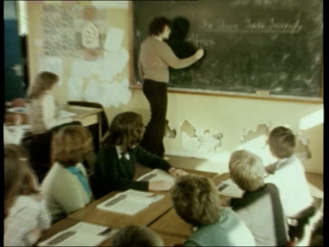 comprehensives urged to specialise itn int 1970s teacher taking class of pupils zoom in to flaking plaster on walls tms flaking plaster along bottom... - 1970 stock videos & royalty-free footage