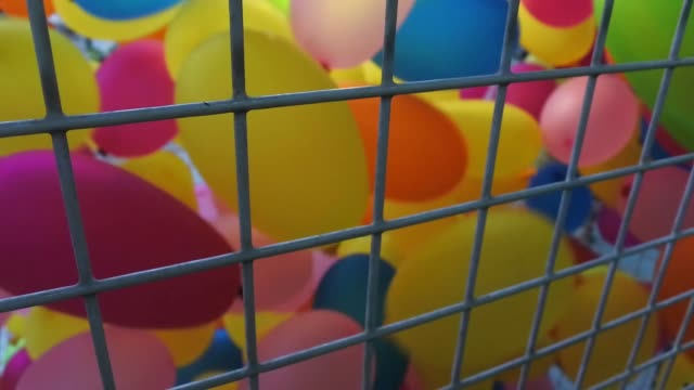 Compressed colorful balloons
