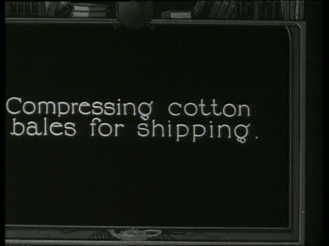"""slate """"compressing cotton bales for shipping"""" / 1910 / no sound - 1910 stock-videos und b-roll-filmmaterial"""