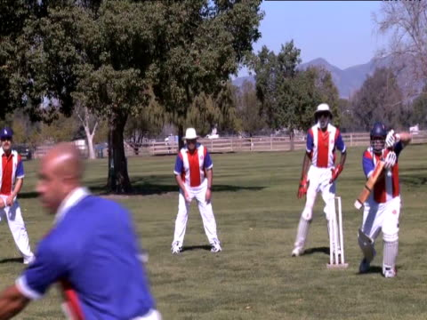 compton cricket club team members describe cricket as similar to 'west indian baseball' during practice in los angeles for a tour in australia - クリケットバット点の映像素材/bロール