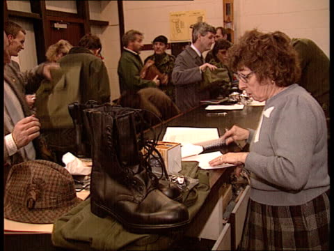 mod compulsory call up of reservists england hants aldershot cs army boots pull out kit being issued to reservists/ta cbv female in camouflage gear... - sergeant stock videos and b-roll footage