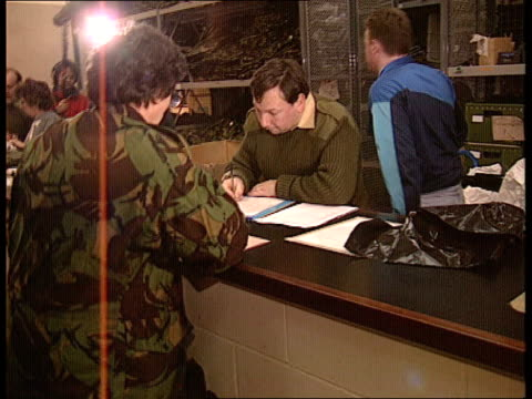 mod compulsory call up of reservists england hants aldershot cbv reservist in camouflage gear standing at counter waiting to collect more gear cms... - aldershot stock videos & royalty-free footage