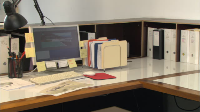 CU, Computer and architectural plans on desk