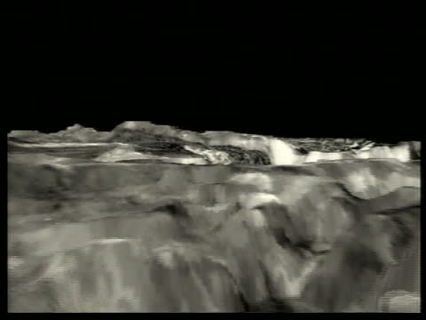 Computer animated AERIAL over Miranda, Uranus' moon