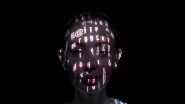 computer characters projected on a woman's face - human face abstract stock videos & royalty-free footage