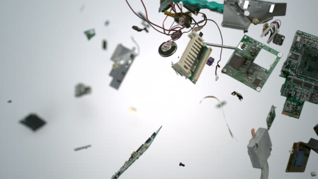 computer chips and parts flying in the air, slow motion-close up - elektronik industrie stock-videos und b-roll-filmmaterial