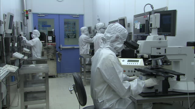 ms, computer clean room technicians at work, singapore - clean room stock videos and b-roll footage