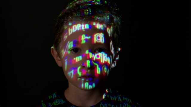 computer data projection on a boy's face - coding stock videos & royalty-free footage