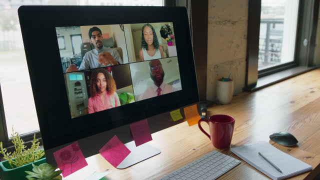 computer displays four people talking in a virtual call - hot desking stock videos & royalty-free footage