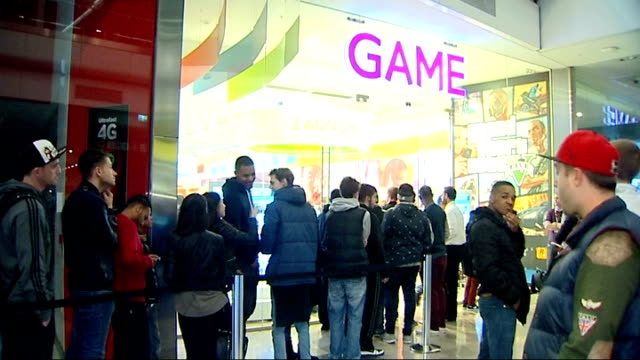 computer games: grand theft auto 5 goes on sale; england: london: stratford: westfield stratford city: int / night various of people queueing at... - game night leisure activity stock videos & royalty-free footage