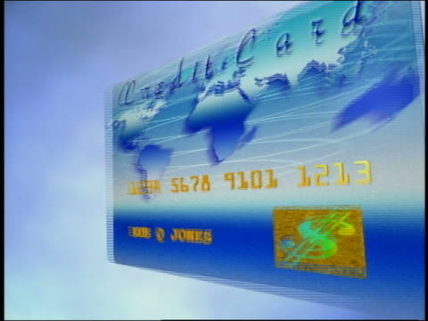 computer generated image close up credit card with world map on it floating forward and receding against blue background - credit card stock videos & royalty-free footage