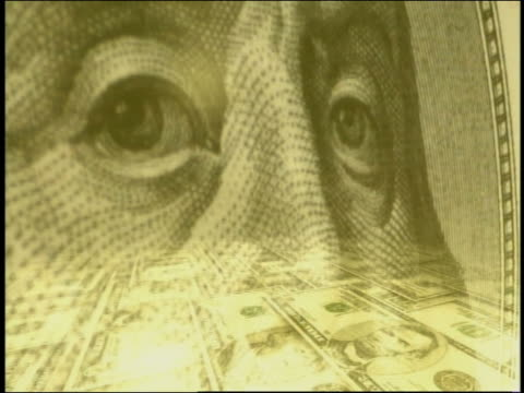 computer generated image extreme close up benjamin franklin portrait on $100 bill with montage of currency, graphs, map of usa - benjamin franklin stock videos & royalty-free footage