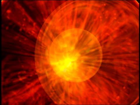 Computer generated image orange sphere emitting rays of orange light towards camera