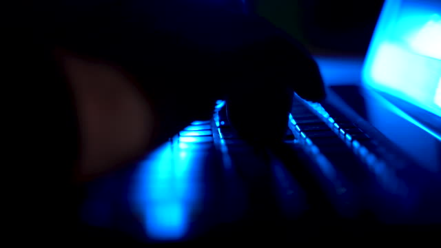 computer hacker typing code on his laptop, close-up - identity stock videos & royalty-free footage