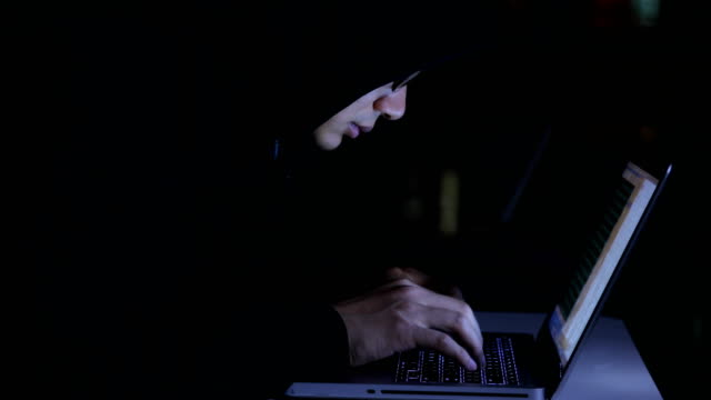 computer hacker working,using laptop at night - huva bildbanksvideor och videomaterial från bakom kulisserna