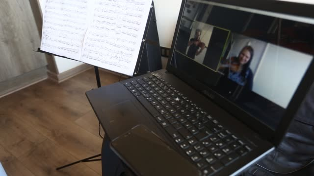 computer is used to chat as venezuelan violinist marlly palacios, who plays in the chamber orchestra of santiago, gives an online lesson to a music... - teacher stock videos & royalty-free footage
