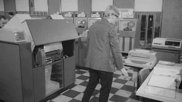 1969 montage computer lab with worker closing printer then data sheet printing out / united kingdom - printer occupation stock videos and b-roll footage