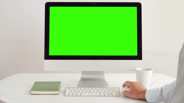 computer: message display on green screen chroma key. man sips coffee. - businesswear stock videos & royalty-free footage