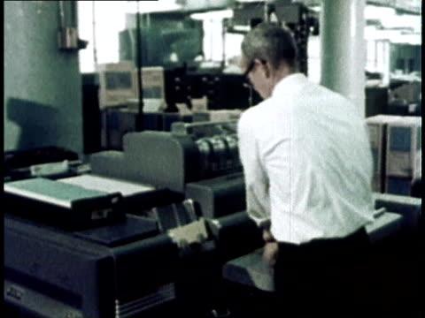 vidéos et rushes de 1967 montage computer programmer using punch cards / usa - reportage