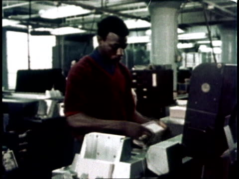 1967 montage computer room clerk / usa - punch card reader stock videos & royalty-free footage