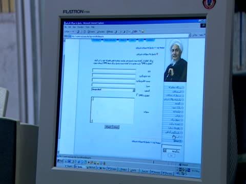 computer screen as user scrolls through an arabic web site / qom, iran - letterbox format stock videos & royalty-free footage