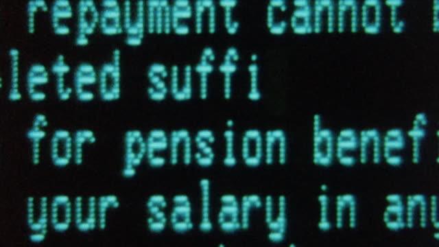 MONTAGE Computer screen displaying data and typist correcting an error / Darlington, England, United Kingdom