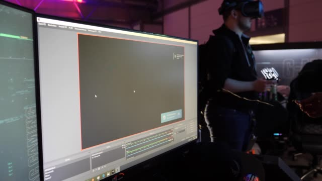computer screen participant using vr-glases to play a video game during a lan party in the expo area at the dreamhack leipzig digital festival on... - participant stock videos & royalty-free footage