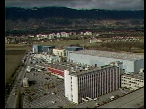 vídeos de stock, filmes e b-roll de computer security; itn lib ext switzerland: cern: nuclear research centre: security guard in post as traffic past tgv cern complex int location... - moving past