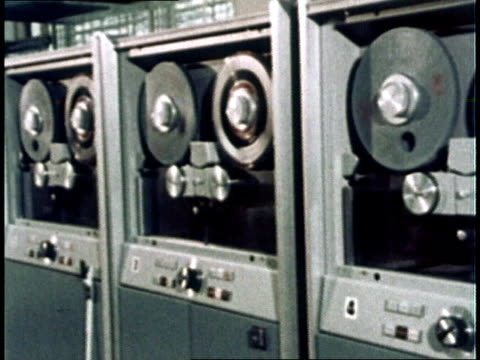1967 montage computer tape reels spinning / usa - film montage stock videos & royalty-free footage