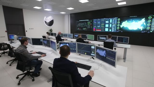 computer technicians monitor bank data operations throughout russia from the control room of the sberbank pjsc data processing center at the skolkovo... - security stock videos & royalty-free footage