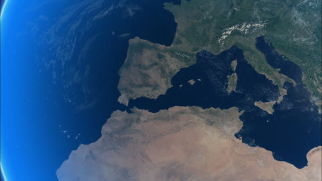 a computer-generated image shows northwest africa joining with southern europe. available in hd. - europa continente video stock e b–roll