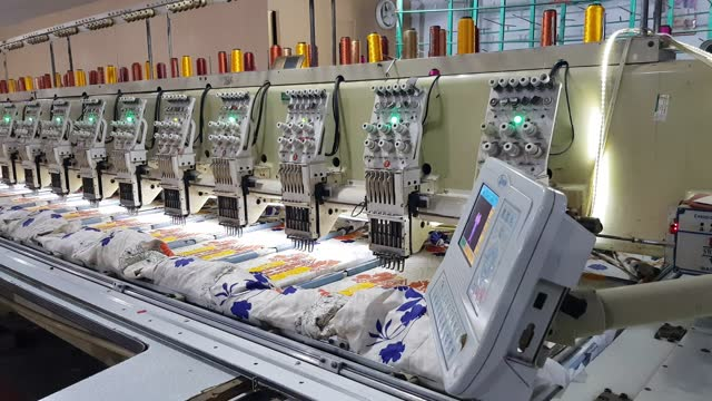 computerized textile embroidery machine in working process. - needle plant part stock videos & royalty-free footage