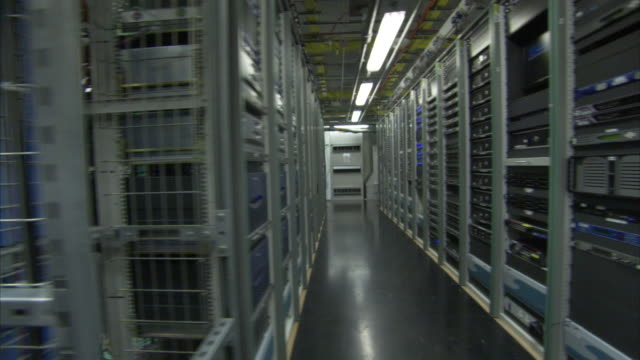 computers fill rows of racks in a large server room. - network server stock videos & royalty-free footage