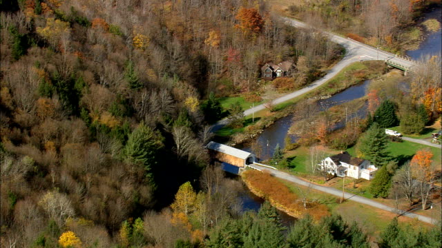 comstock covered bridge over trout river - aerial view - vermont,  franklin county,  united states - wood material stock videos & royalty-free footage