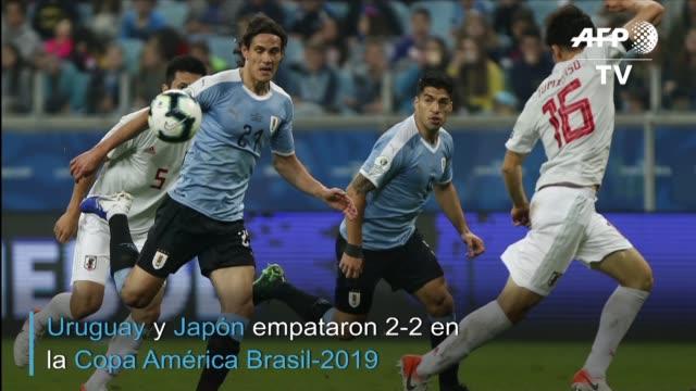 con dos goles de koji miyoshi japon el empato 22 la noche del jueves a uruguay en el partido que abrio la segunda fecha del grupo c de la copa... - 2010 2019 stock videos & royalty-free footage