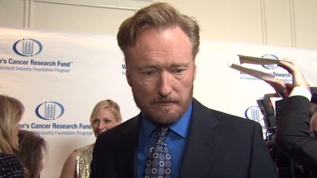 conan o'brien on the event at the 14th annual unforgettable evening benefiting the entertainment industry foundation's women's cancer research fund... - conan o'brien stock videos and b-roll footage