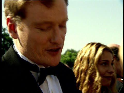 conan o'brien talks to reporters on red carpet at the 50th annual emmy awards - conan o'brien stock videos and b-roll footage