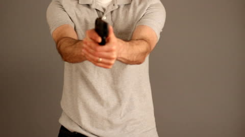 concealed carry gun draw - handgun stock videos & royalty-free footage