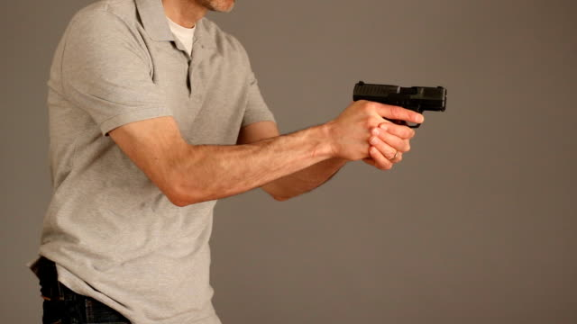 concealed carry gun draw - trousers stock videos & royalty-free footage