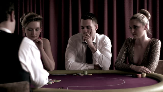 concentrated dealer dealing cards - casino cards stock videos & royalty-free footage