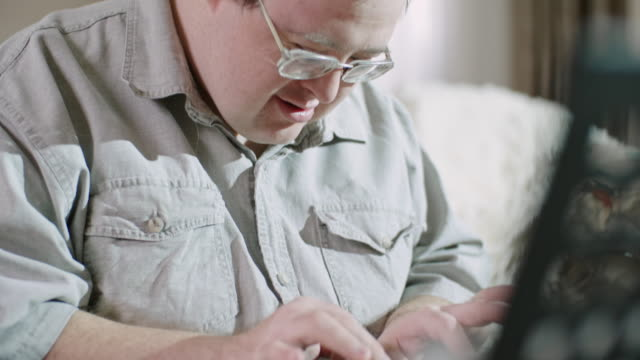 concentrated man with intellectual disability playing piano - intellectual disability stock videos & royalty-free footage