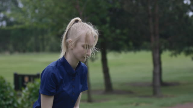 concentrated teen golfer - green golf course stock videos & royalty-free footage
