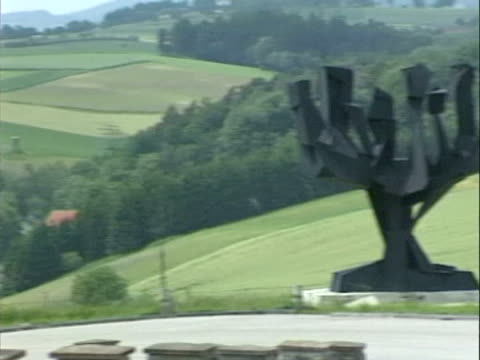 / concentration camp exterior / various memorials and surrounding countryside