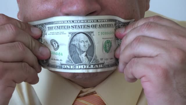 conceptual image of a bribe to remain silent - bribing stock videos & royalty-free footage