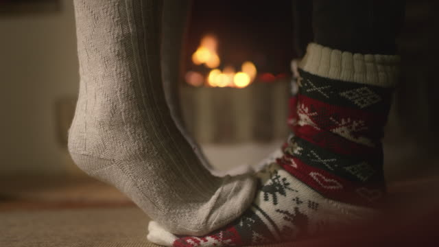 cu conceptual shot of a couple kissing by the fireplace - sock stock videos & royalty-free footage