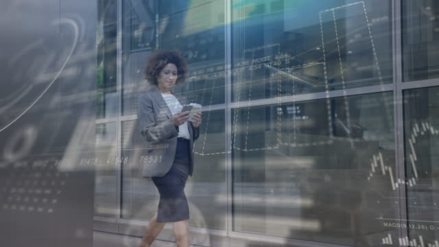 vídeos de stock e filmes b-roll de conceptual shot of businesswoman using digital tablet technology with futuristic finance infographics, digital composite - visor digital