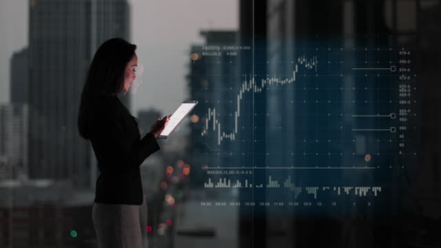 vidéos et rushes de conceptual shot of businesswoman with infographics digital composite - activité bancaire