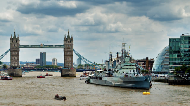 conceptual view of london. thames river. tower bridge. hms belfast - warship stock videos & royalty-free footage