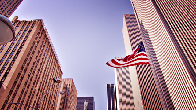 conceptual view of united state business. american flag. corporate financial building. 6th avenue, financial district. - manhattan financial district stock videos & royalty-free footage