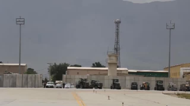 concern as taliban gain ground and foreign troops withdraw; afghanistan: parwan province: bagram airfield: ext wide shot air base control tower... - bagram stock videos & royalty-free footage